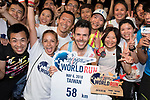 Luis Ricardo (C) of Portugal poses with participants after winning The Wings for Life World Run along Taoyuan district on Sunday, May 6, 2018 in Taiwan. Photo by Victor Fraile / Power Sport Images