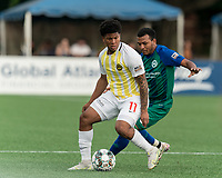 HARTFORD, CT - AUGUST 17: Nicque Daley #11 of Charleston Battery controls the ball as Christian Gomez #8 of Hartford Athletic defends during a game between Charleston Battery and Hartford Athletic at Dillon Stadium on August 17, 2021 in Hartford, Connecticut.
