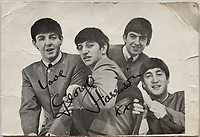 BNPS.co.uk (01202 558833)<br /> Pic: OmegaAuctions/BNPS<br /> <br /> Pictured: A picture of the Beatles signed by George Harrison is part of the sale<br /> <br /> A collection of letters George Harrison's mother wrote to a Beatles fan over a five-year period has emerged for sale.<br /> <br /> Louise Harrison wrote to super fan Lorraine O'Malley from August 1964 until her death in 1970, sharing notable events in the band and Harrison's life like the band getting MBEs and her son's marriage to Pattie Boyd.<br /> <br /> Mrs O'Malley, who started writing as a star-struck 16-year-old, kept the letters safely stored in a safety deposit box for the next 50 years.<br /> <br /> She has now decided to put the 55 letters up for sale with Omega Auctions, based in Merseyside, with an estimate of £6,000.