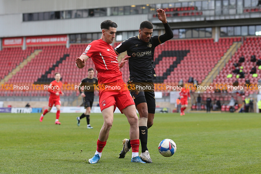 Conor Wilkinson of Leyton Orient and Kyle Jameson of Oldham Athletic during Leyton Orient vs Oldham Athletic, Sky Bet EFL League 2 Football at The Breyer Group Stadium on 27th March 2021