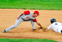 21 August 2010: Brooklyn Cyclones infielder Justin Schafer attempts to tag a sliding Chad Mozingo (4) during game action against the Vermont Lake Monsters at Centennial Field in Burlington, Vermont. The Cyclones defeated the Lake Monsters 8-7 in a 12-inning game that had to be resumed in Brooklyn on August 31 due to late inning rain. Mandatory Credit: Ed Wolfstein Photo