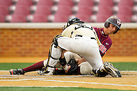 Wake Forest Demon Deacons catcher Brett Armour #6 tags out Brendon Hayden #34 of the Virginia Tech Hokies as he tries to score a run at Wake Forest Baseball Park on April 21, 2012 in Winston-Salem, North Carolina.  The Demon Deacons defeated the Hokies 8-6.  (Brian Westerholt/Four Seam Images)