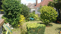 BNPS.co.uk (01202) 558833. <br /> Pic: MikeClifford/BNPS<br /> <br /> Pictured: Mike's garden before the transformation. <br /> <br /> A gardener who spent years cultivating some of the world's rarest plants is opening his exotic bungalow garden for charity. <br /> <br /> Mobile home designer, Mike Clifford, began tropical gardening over 20 years ago when he was inspired by a documentary on the subject.  <br /> <br /> Since then, he and his wife Tina, who makes cakes for visitors, have cultivated thousands of plants from across the globe in their quaint English garden.