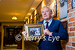 Der O'Sullivan holding a photo of his grandparents Tom and Gertie Dillon