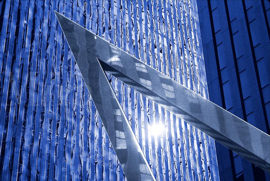 Graphic sculpture against striking modern building facades.  Manhattan, New York, United States of America..