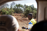 Two time  World Champion marathon runner Abel Kirui reaches for a bottle of water from coach Renato Canova during a training session outside of Iten, Kenya.