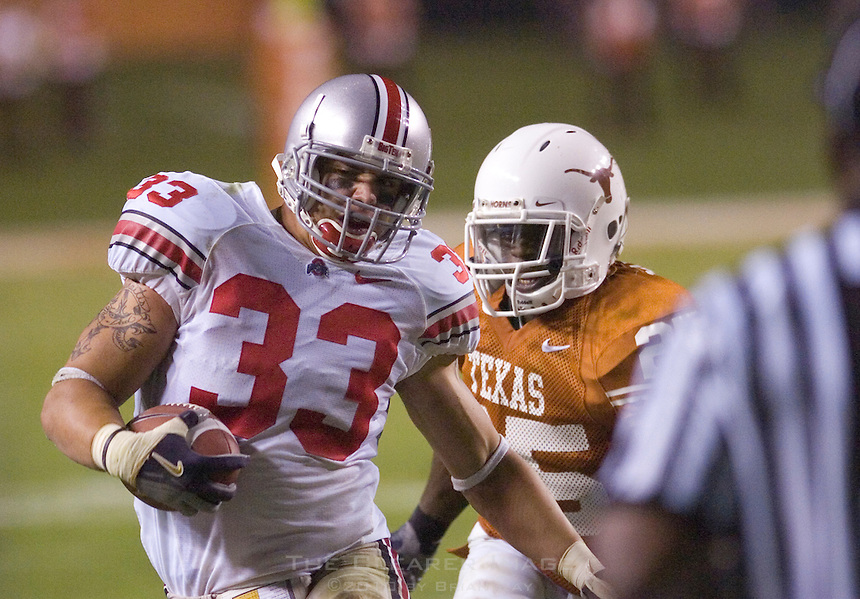 09 September 2006: Ohio State linebacker James Laurinaitis (#33) is knocked out of bounds by Texas running back Jamaal Charles while returning an interception during the third quarter of the Buckeyes 24-7 victory over the Texas Longhorns at Darrell K Royal Memorial Stadium in Austin, TX.