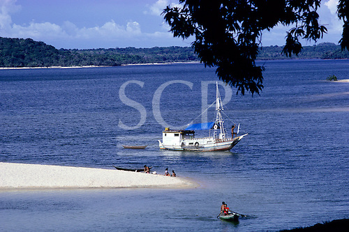 Alter do Chao, Brazil. River beach with holidaymakers on a riverboat; Tapajos River, Para State, Amazon.