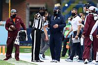 CHAPEL HILL, NC - OCTOBER 10: North Carolina head coach Mack Brown talks with Side Judge Jamal Shears during a game between Virginia Tech and North Carolina at Kenan Memorial Stadium on October 10, 2020 in Chapel Hill, North Carolina.