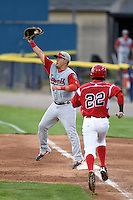 Lowell Spinners first baseman Cisco Tellez (48) stretches for a throw as Javier Lopez (22) runs up the line during a game against the Batavia Muckdogs on July 18, 2014 at Dwyer Stadium in Batavia, New York.  Lowell defeated Batavia 11-2.  (Mike Janes/Four Seam Images)