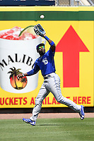 Dunedin Blue Jays outfielder Dwight Smith Jr. (25) catches a fly ball during a game against the Clearwater Threshers on April 6, 2014 at Bright House Field in Clearwater, Florida.  Dunedin defeated Clearwater 5-2.  (Mike Janes/Four Seam Images)