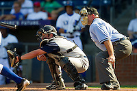 Catcher Adam Ricks #16 of the Charlotte Knights sets a target as home plate umpire Craig Barron looks on during the first game of a double header against the Durham Bulls at Durham Bulls Athletic Park on August 28, 2011 in Durham, North Carolina.   (Brian Westerholt / Four Seam Images)