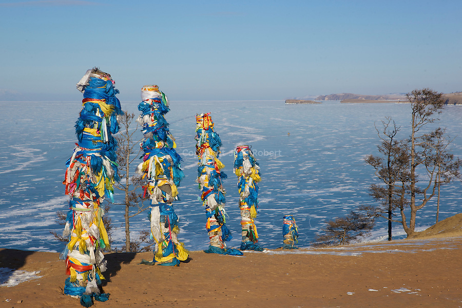 Holy rocks of Khoujir on Olkhon island, a place of veneration for all Baikal and mongolians  shamans and Buddhists.nthe trees are draped in prayer flags and festooned with pujas offering to the spirits...rochers sacrés de Khoujir sur l'île d'Olkhon.