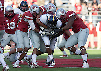Jeremy Ross continues forward motion despite defenders on the play. The University of California football defeated Washington State University 20-13 at Martin Stadium in Pullman, Washington on November 6th, 2010.