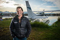 Sportsman's Lodge Owner, UAA Alum and former Seawolf hockey player Brian Kraft, Marketing '92, with his Cessna 206 at Lake Hood in Anchorage.