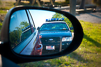 Police Ford car in side mirror