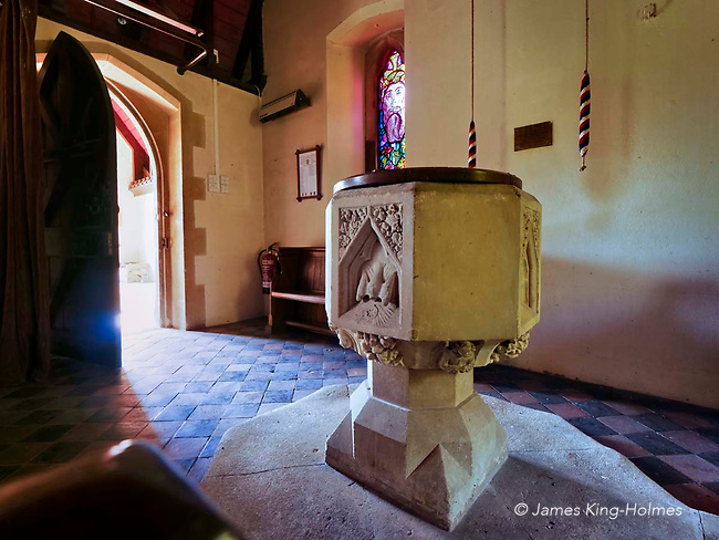 Detail of the font and narthex of St Lawrence Church, Tubney, Oxfordshire, UK. This is the only Protestant church designed by Augustus Pugin. The interior fittings were designed by him and remain unchanged since the church's consecration in 1847.