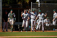 Dartmouth Big Green Ben Rice (9), Kolton Freeman (28), Nathan Skinner (15), and Trystan Sarcone (14) during a game against the Omaha Mavericks on February 23, 2020 at North Charlotte Regional Park in Port Charlotte, Florida.  Dartmouth defeated Omaha 8-1.  (Mike Janes/Four Seam Images)