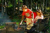 Roasting hotdogs at family picnic at Trail Lake Campground, Kenai Peninsula, Chugach National Forest, Alaska.