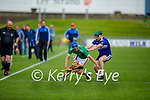 Ballyduffs Dylan Moriarty attempts to take possession as Eoghan Kearney of St Brendan's bares down on him,  in round 2 of the County Hurling Championship