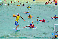 Visitors, spectators watch a surf polo / soccer competition between lifeguard teams in Waikiki on the occasion of legendary surfer Duke Kahanamoku's birthday celebration.