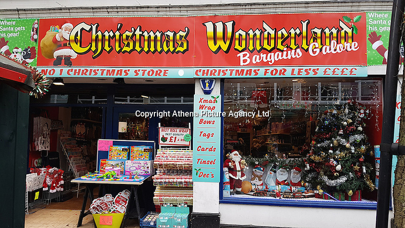 """Pictured: The Christmas Wonderland pop-up shop in Swansea, Wales, UK<br /> Re: A pop-up trader has been condemned for """"peddling festive porn"""" by stocking raunchy boob and willy merchandise alongside the tinsel and mistletoe.<br /> Shocked families with young kids expecting to snap up a cheap bauble are greeted by inflatable penises, sponge willies and an array of gaudy erections doubling as money boxes.<br /> Bargain hunters in Swansea were drawn to the Christmas Wonderland pop-up shop when it appeared this week at the centre of the city's popular festive market.<br /> While some find the sexually explicit stock just a bit of fun, families are furious that very young kids are greeted with """"filth.""""<br /> Boasting """"Bargains Galore"""" a shop sign outside lists bows, tinsel, tags and Xmas wrap among its festive stock - but makes no mention of squeeze boobs or penis stethoscopes.<br /> """"My kids were all excited to go round the colourful Christmas market. But once we walked inside the kids came face to face with filth,"""" said a young mum, from Sketty, Swansea, who did not want to be named.<br /> """"My daughter is only seven and her brother's five. I would never knowingly let them go into a shop which stocks this kind of stuff.<br /> """"I don't want to sound like a prude but a shop like this should be for adults only. They are peddling festive porn. It's junk as far as l'm concerned."""