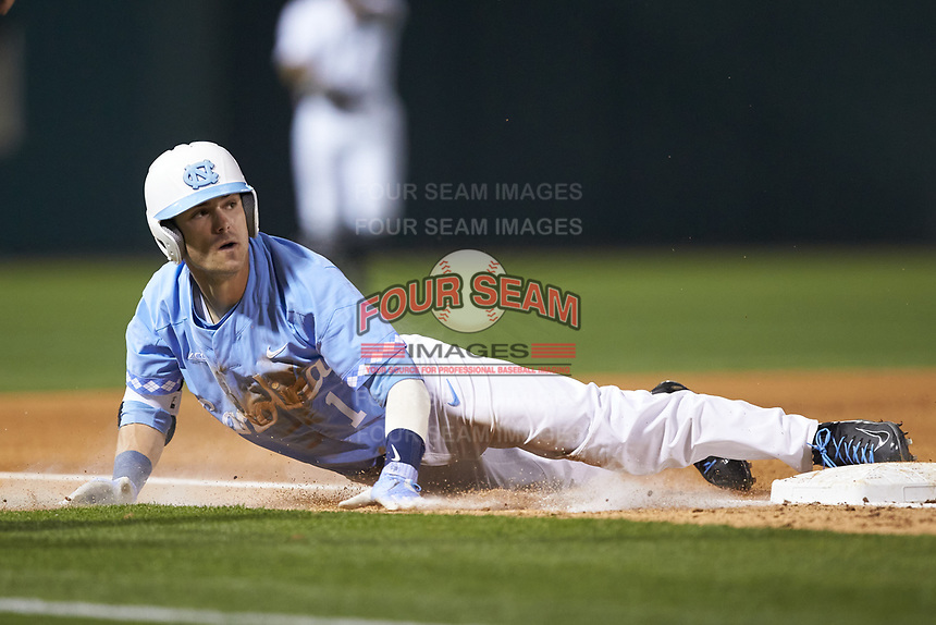 Brandon Riley (1) of the North Carolina Tar Heels slides into third base against the South Carolina Gamecocks at BB&T BallPark on April 3, 2018 in Charlotte, North Carolina. The Tar Heels defeated the Gamecocks 11-3. (Brian Westerholt/Four Seam Images)