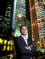 James Murdoch, poses near HK Legco. Central. He is the youngest son of the broadcaster's chairman and biggest shareholder, Rupert Murdoch. He was the Chief Executive of Satellite broadcaster BSkyB in 2004.  He is the former chairman and chief executive of News Corp., Europe and Asia, where he oversaw assets such as News International, publisher of The News of the World newspaper, Sky Italia, Sky Deutschland and Star TV.  `he is the chief executive officer of 21st Century Fox and chairman of Sky Inc.