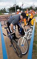 13 SEP 2014 - IPSWICH, GBR - Referee Steve Copping checks bikes before the start of the 2014 British Open Club Cycle Speedway Championships at Whitton Sports & Community Centre in Ipswich, Great Britain (PHOTO COPYRIGHT © 2014 NIGEL FARROW, ALL RIGHTS RESERVED)
