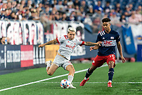 FOXBOROUGH, MA - JULY 7: Yeferson Soteldo #30 of Toronto FC passes the ball asBrando Bye #15 of New England Revolution defends during a game between Toronto FC and New England Revolution at Gillette Stadium on July 7, 2021 in Foxborough, Massachusetts.