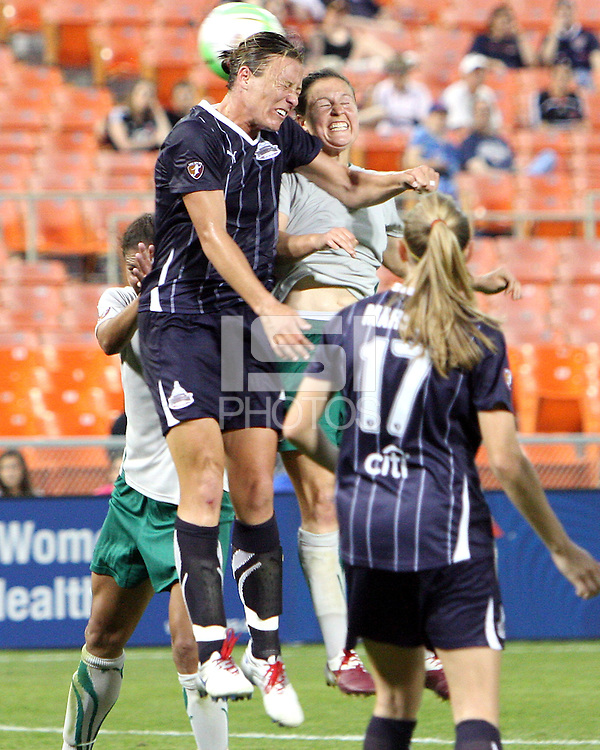 Abby Wambach #20 of the Washington Freedom clashes with Carolyn Blank #3 during a WPS match against St. Louis Athletica on May 1 2010, at RFK Stadium, in Washington D.C.Freedom won 3-1.