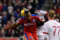 Harrison, NJ - Thursday March 01, 2018: Rony Martínez, Kemar Lawrence. The New York Red Bulls defeated C.D. Olimpia 2-0 (3-1 on aggregate) during a 2018 CONCACAF Champions League Round of 16 match at Red Bull Arena.