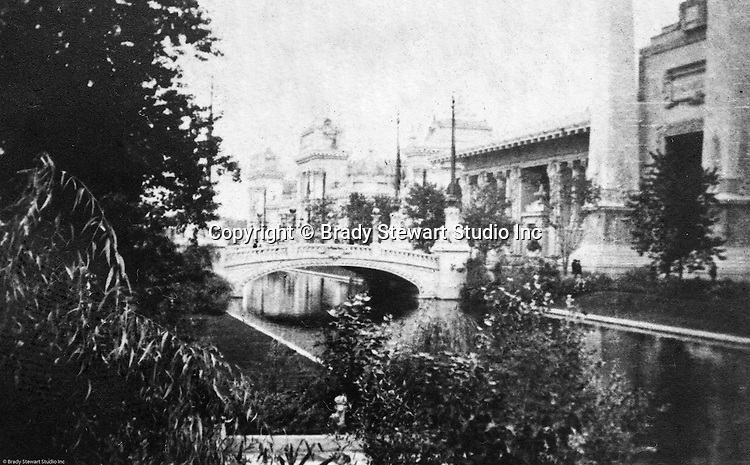 St Louis MO:  View of the Palace of Mines and Metallurgy from across the traverse lagoon at the Louisiana Purchase Exposition.  Palace of Liberal Arts in the background