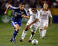Kansas City Wizards midfielder Carlos Marinelli (10) moves upfield with the ball as Galaxy midfielder Alvaro Pires (15) follows during a MLS match. The LA Galaxy defeated the Kansas City Wizards 3-1 at Home Depot Center stadium in Carson, Calif., on Saturday, May 24, 2008.