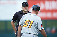 Umpire Ben Fernandez listens as West Virginia Power manager Wyatt Toregas (51) argues a call during the game against the Kannapolis Intimidators at Kannapolis Intimidators Stadium on July 25, 2018 in Kannapolis, North Carolina. The Intimidators defeated the Power 6-2 in 8 innings in game one of a double-header. (Brian Westerholt/Four Seam Images)