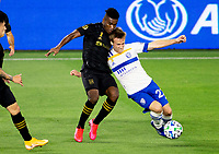 LOS ANGELES, CA - SEPTEMBER 02: Tommy Thompson #22 of the San Jose Earthquakes moves to the ball past Jose Cifuentes #11 of LAFC during a game between San Jose Earthquakes and Los Angeles FC at Banc of California stadium on September 02, 2020 in Los Angeles, California.