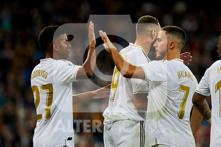 Rodrygo Goes (L) and Eden Hazard (R) of Real Madrid celebrate goal during La Liga match between Real Madrid and CD Leganes at Santiago Bernabeu Stadium in Madrid, Spain. October 30, 2019. (ALTERPHOTOS/A. Perez Meca)
