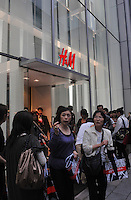 Shoppers outside the newly opened H&M store in Ginza district, Tokyo, Japan. H&M plans to open its second Japan store in November, in Tokyo's fashionable Harajuku district, where it will feature a collection created for H&M by Japanese designer Rei Kawakubo of Comme des Garcons Ltd..