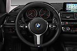 Car pictures of steering wheel view of a 2017 BMW 1-Series Sport 5 Door Hatchback