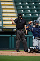 Bradenton Marauders Umpire Tanner Dobson calls a strike during a Florida State League game against the Charlotte Stone Crabs on April 10, 2019 at LECOM Park in Bradenton, Florida.  Bradenton defeated Charlotte 2-1.  (Mike Janes/Four Seam Images)