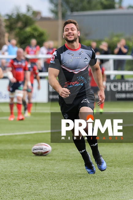 William Barthau of London Broncos celebrates after he scores a try during his 50th appearance for London Broncos during the Kingstone Press Championship match between London Broncos and Featherstone Rovers at Castle Bar , West Ealing , England  on 25 June 2017. Photo by David Horn.