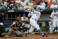 UCLA outfielder Eric Filia (4) drives in a run in the first inning against the Mississippi State Bulldogs during the 2013 Men's College World Series Final on June 25, 2013 at TD Ameritrade Park in Omaha, Nebraska. The Bruins defeated the Bulldogs 8-0, winning the National Championship. (Andrew Woolley/Four Seam Images)