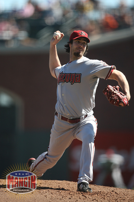 SAN FRANCISCO - OCTOBER 1:  Dan Haren #15 of the Arizona Diamondbacks pitches against the San Francisco Giants during the game at AT&T Park on October 1, 2009 in San Francisco, California. Photo by Brad Mangin