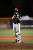 Salem-Keizer Volcanoes relief pitcher Alex DuBord (49) looks in for the sign during a Northwest League game against the Hillsboro Hops at Ron Tonkin Field on September 1, 2018 in Hillsboro, Oregon. The Salem-Keizer Volcanoes defeated the Hillsboro Hops by a score of 3-1. (Zachary Lucy/Four Seam Images)