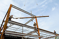02/22/07:  Construction workers carefully pull in a steel beam to be attached during expansion/construction of a Charlotte-area shopping center. Charlotte, NC, is one of the country's fastest-growing cities. ..By Patrick Schneider- Patrick Schneider Photography.