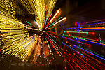Holiday Lights, Sedona, Arizona  ©2017 James D Peterson.  Sedona's Tlaquepaque Arts and Crafts Village really knows how to celebrate holidays.  This Christmas display was put into warp drive by zooming my lens while the shutter was open.