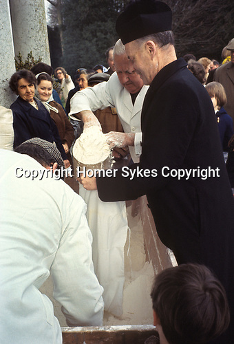 Tichborne Dole. Tichborne, near Arlesford, Hampshire. UK. Annually on Lady Day, March 25th 1970s. The family Roman Catholic priest collects the dole.