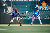 Amarillo Sod Poodles Hudson Potts (10) leads off first base in front of Frisco RoughRiders first baseman Andretty Cordero (4) during a Texas League game on May 19, 2019 at Dr. Pepper Ballpark in Frisco, Texas.  Amarillo defeated Frisco 10-5.  (Mike Augustin/Four Seam Images)