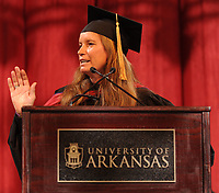 NWA Democrat-Gazette/ANDY SHUPE<br /> The Rev. Becca Stevens speaks Saturday, May 13, 2017, during commencement exercises in Bud Walton Arena in Fayetteville. Visit nwadg.com/photos to see more photographs from the ceremony.