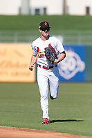Surprise Saguaros center fielder Lane Thomas (23), of the St. Louis Cardinals organization, jogs off the field between innings of an Arizona Fall League game against the Peoria Javelinas at Surprise Stadium on October 17, 2018 in Surprise, Arizona. (Zachary Lucy/Four Seam Images)